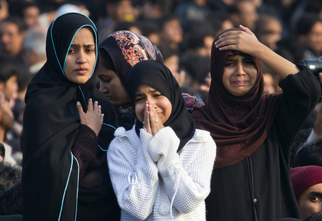 Pakistani Shiite Muslim girls mourn during a Muharram procession in Islamabad, Pakistan, Saturday, Nov. 24, 2012. Muharram is a month of mourning in remembrance of the martyrdom of Imam Hussein, the g