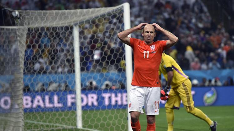 ' Arjen Robben reacts after missing a chance during the World