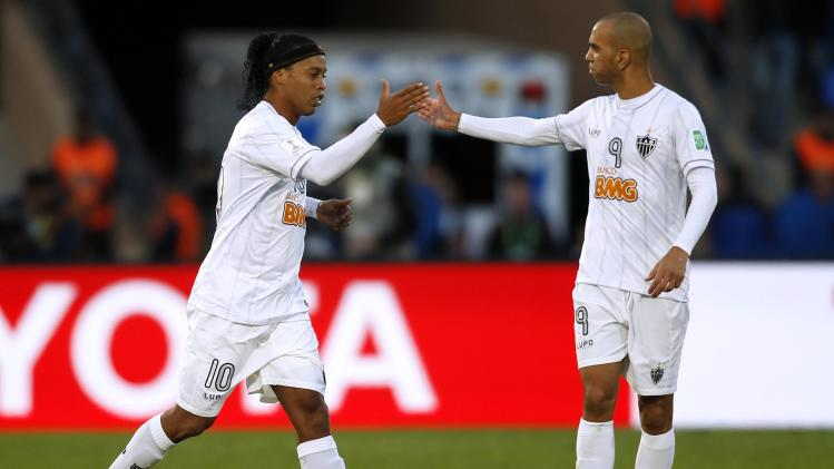 Ronaldinho of Brazil's Atletico Mineiro celebrates with Diego Tardelli after scoring a goal during their 2013 FIFA Club World Cup third place soccer match against China's Guangzhou Evergrande in Marrakech stadium