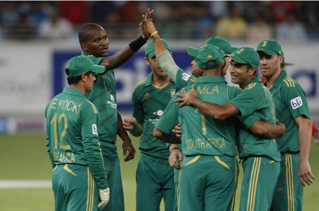 South Africa's Lonwabo Tsotsobe celebrates with his team mates the wicket of Pakistan's Ahmed Shehzad during their first Twenty20 international cricket match in Dubai