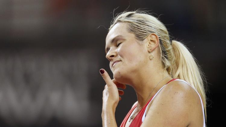 Canada's Wozniak reacts after a shot against Slovakia's Cepelova during their Fed Cup tennis match at the PEPS stadium at Laval University in Quebec City