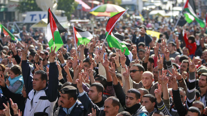 People wave Palestinian flags during a rally supporting the Palestinian UN bid for observer state status, in the West bank city of Ramallah, Thursday, Nov. 29, 2012. The Palestinians are certain to win U.N. recognition as a state on Thursday but success could exact a high price: delaying an independent state of Palestine because of Israel's vehement opposition. (AP Photo/Majdi Mohammed)