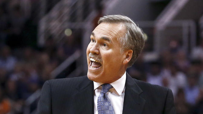 Los Angeles Lakers' Mike D'Antoni argues with an official in the first half of an NBA basketball game against the Phoenix Suns on Monday, March 18, 2013, in Phoenix. (AP Photo/Ross D. Franklin)
