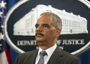 U.S. Attorney General Eric Holder stands during a news conference after BNP Paribas pleaded guilty, in Washington