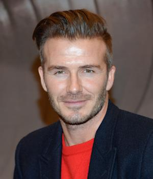 FILE - In a Saturday, Feb. 1, 2014 file photo, former England soccer player and model David Beckham makes an appearance at H&M Times Square for his new men's underwear line, in New York. Beckham will take part in a news conference Wednesday, Feb. 5, 2014 to discuss his progress in trying to bring a Major League Soccer expansion team to Miami. MLS Commissioner Don Garber and Miami-Dade County Mayor Carlos Gimenez also will attend the session, which was announced Monday, Feb. 3. The league has discussed placing its next two expansion teams in Miami and Atlanta. (Photo by Evan Agostini/Invision/AP, File)