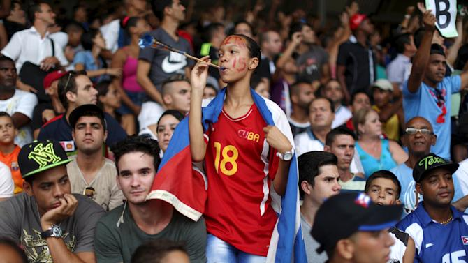 Sister of Cuba's national soccer player Diz Pe reacts moments before the match between New York Cosmos and Cuba's national team in Havana