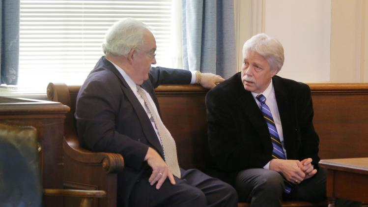 Mark Strong, Sr. talks with his attorney Dan Lilley after Justice Nancy Mills dropped most of the  charges against Strong, Friday, Jan. 25, 2013 at York County Superior Court in Alfred, Maine. Strong is on trial for helping Alexis Wright run a one-woman prostitution business from a Kennebunk dance studio. (AP Photo/Portland Press Herald, Gregory Rec, Pool)