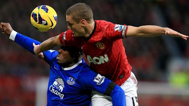 Everton's Victor Anichebe (left) and Manchester United's Nemanja Vidic (right) battle for the ball (PA Photos)