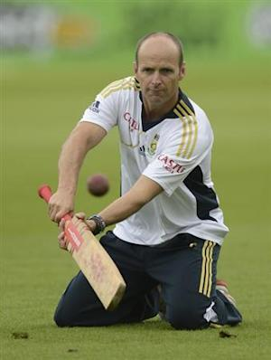 South Africa's coach Gary Kirsten hits a ball during a training session before Thursday's first cricket test match against England at the Oval cricket ground in London July 18, 2012. REUTERS/Philip Brown/Files