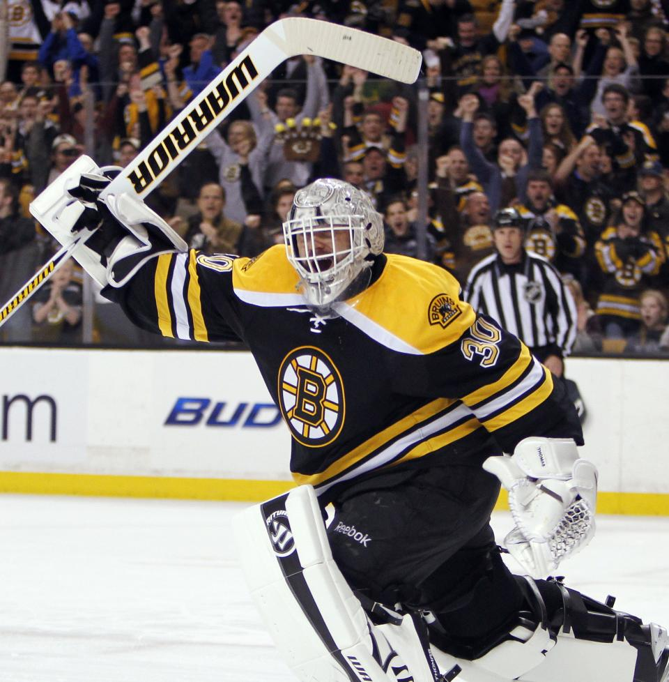 Boston Bruins' Tim Thomas celebrates after blocking the shot by Buffalo Sabres' Jason Pominville, giving the Bruins a 4-3 win, in a shootout during an NHL hockey game in Boston, Saturday, April 7, 2012. (AP Photo/Michael Dwyer)