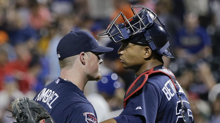 Atlanta Braves pitcher Craig Kimbrel (46) greets catcher Christian Bethancourt (25) after closing for a save against the New York Mets in a baseball game, Thursday, July 10, 2014, in New York. The Braves won 3-1. (AP Photo/Julie Jacobson)