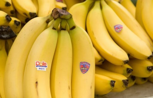 <p>This file photo shows Dole bananas for sale at a market in Washington, DC. Japanese trading house Itochu says it is in talks with Dole Food to buy the US firm's packaged-foods and Asian fresh fruit and vegetable businesses, reportedly for as much as $1.7 billion.</p>
