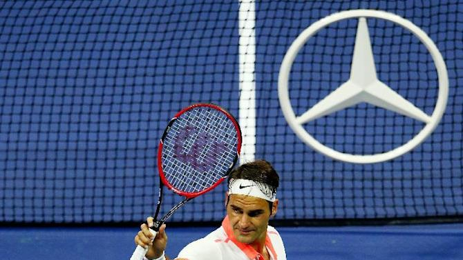 Tennis - Darcis win is no sweat for formidable Federer