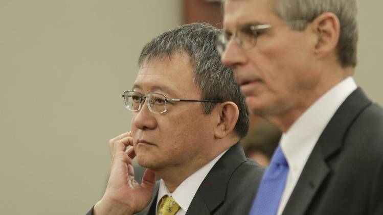 Richard Suen, left, talks with a member of his counsel during a recess in his lawsuit against the Las Vegas Sands Corp., Thursday, April 4, 2013, in Las Vegas. The Hong Kong businessman, is suing the Las Vegas Sands Corp. claiming he made it possible for the casino company to win a license in Macau by arranging meetings between executives and Beijing officials in 2001 and that he and his company were promised a $5 million success fee and 2 percent of net casino profits in exchange for helping Sands open its first casino in Macau, currently the world's biggest gambling market. (AP Photo/Julie Jacobson)
