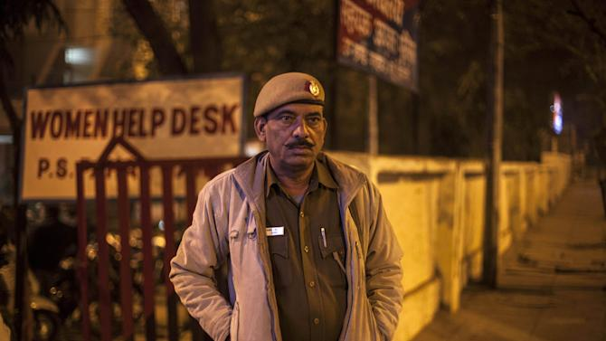An Indian policeman stands outside the police station which is investigating the gang-rape of a Danish tourist in New Delhi, India, Wednesday, Jan. 15, 2014. A 51-year-old Danish tourist was gang-raped near a popular shopping area in New Delhi after she stopped to ask for directions, police said Wednesday, the latest case to focus attention on the scourge of violence against women in India. The woman managed to reach her hotel in Paharganj area Tuesday evening and the owner called police. (AP Photo/Tsering Topgyal)