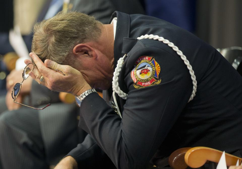 Mayer fire department chaplain Rev. Bob Ossler, reacts during a memorial service for 19 wildland firefighters, Monday, July 1, 2013 in Prescott, Ariz. Nineteen Hotshot firefighters were killed on Sunday when when an out-of-control blaze overtook the elite group near Yarnell, Ariz. (AP Photo/Julie Jacobson)