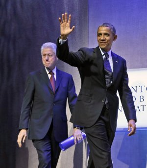 President Barack Obama, right, walks on stage with …