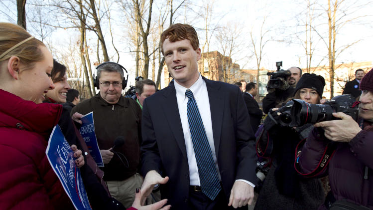Joseph Kennedy III greets people at the Newton Center Green Line MBTA Station, in Newton, Mass., Thursday, Feb. 16, 2012. Kennedy, who released a video announcement on his campaign website early Thursday, launched his campaign for the Massachusetts congressional seat now held by retiring U.S. Rep. Barney Frank. Kennedy is the son of former U.S. Rep. Joseph Kennedy II and a grandson of the late Robert F. Kennedy. (AP Photo/Steven Senne)