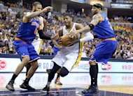 New York Knicks' Tyson Chandler (L) and Kenyon Martin try to block Paul George (C) of the Indiana Pacers on May 14, 2013. The Indiana Pacers are on the brink of advancing to the NBA semi-finals after beating New York 93-82