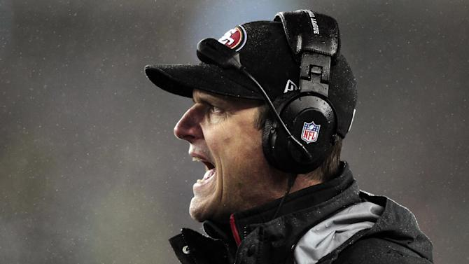 San Francisco 49ers head coach Jim Harbaugh shouts from the sidelines in the first quarter of an NFL football game against the New England Patriots in Foxborough, Mass., Sunday, Dec. 16, 2012. (AP Photo/Steven Senne)