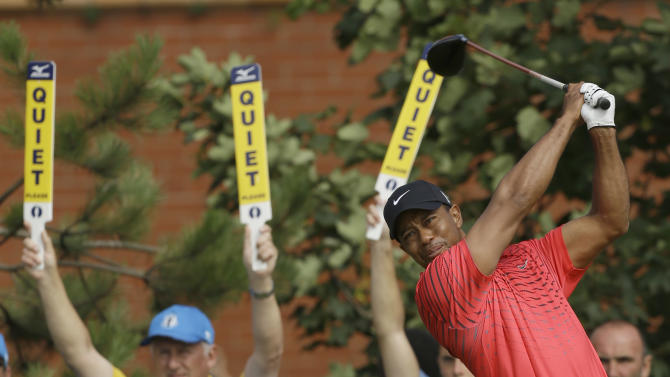 Tiger Woods of the United States plays a shot off the 10th tee at Royal Lytham & St Annes golf club during the final round of the British Open Golf Championship, Lytham St Annes, England Sunday, July  22, 2012. (AP Photo/Jon Super)