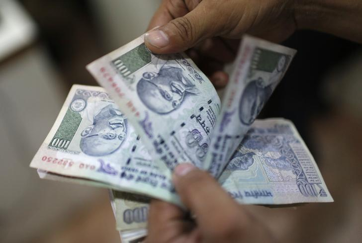Tax worries drag rupee to over 1-mth low, stocks slip