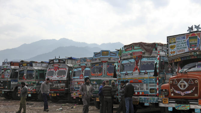 Indian trucks drivers wait for the reopening of the Line of Control (LOC) trade centre at the Chakan Da Bagh, in Poonch, 245 kilometers (152 miles) northwest of Jammu, India, Monday, Jan. 14, 2013. India's army chief Bikram Singh says a Pakistani attack in which two Indian soldiers were killed in the disputed Kashmir region was premeditated. The violence killed two soldiers on each side with both the countries accusing each other of violating a 2003 ceasefire and summoning their envoys to lodge protest. (AP Photo/Channi Anand)