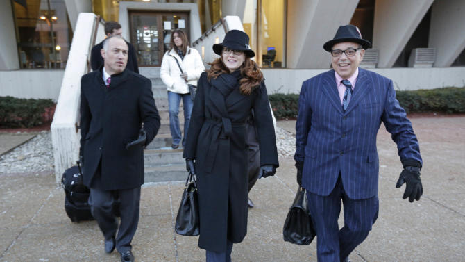 Defense lawyers for Drew Peterson, from left, Steve Greenberg, Lisa Lopez, and Joe Lopez leave the Will County Courthouse Wednesday, Feb. 20, 2013, in Joliet, Ill., after the second day of a hearing in the former suburban Chicago police officer's request for a new trial. The defense is seeking to bolster arguments Peterson deserved a retrial on charges he murdered his third wife, Kathleen Savio. Peterson's attorneys contend his former lead trial attorney, Joel Brodsky, botched his case. After two days of arguments Judge Edward Burmila said he would deliver his ruling when court resumes at 1 p.m. Thursday. (AP Photo/M. Spencer Green)