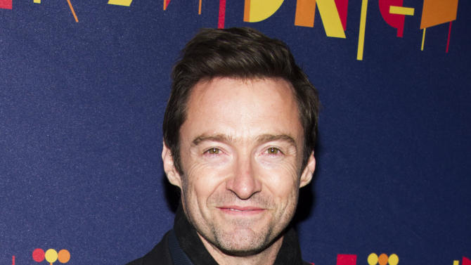 """FILE - This Nov. 3, 2013 file photo shows actor Hugh Jackman at the Broadway opening of """"After Midnight"""" in New York. Jackman says he jacked to host the Tony Awards for the third time, but fans of his stage work won't have to wait long to see the Tony-winning star onstage again. Jackman says he's doing the play """"The River"""" later this year and """"looking forward to treading the boards here on Broadway."""" (Photo by Charles Sykes/Invision/AP, File)"""