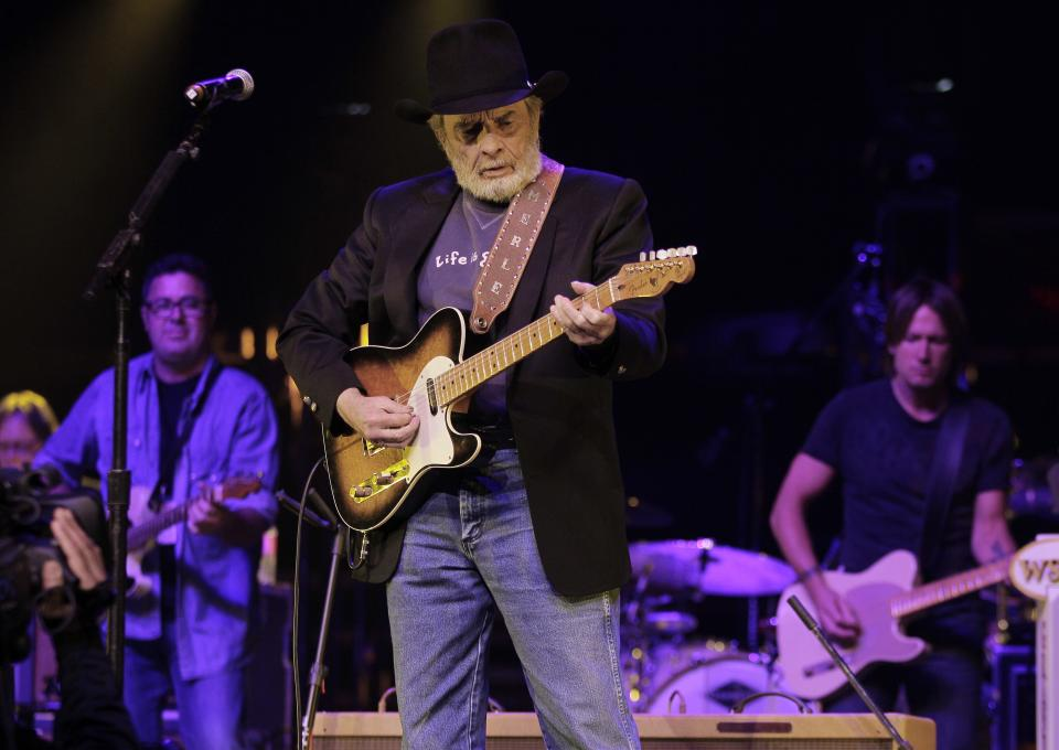 Merle Haggard, center, performs with Vince Gill, left, and Keith Urban, right, during the All for the Hall concert on Tuesday, April 10, 2012, in Nashville, Tenn. The concert is a benefit for the Country Music Hall of Fame and Museum. (AP Photo/Mark Humphrey)