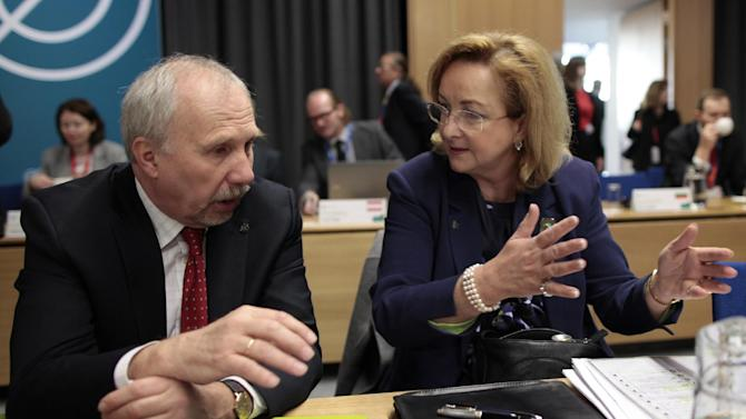 Austria's Finance Minister Maria Fekter, right, speaks with Austria's Director of Central Bank Ewald Nowotny during the Informal meeting of ECOFIN Ministers in Dublin Castle, Ireland, Saturday, April 13, 2013.  (AP Photo/Peter Morrison)