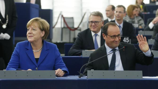 German Chancellor Angela Merkel and French President Francois Hollande arrive at the hemicycle ahead of addressing the European Parliament in Strasbourg