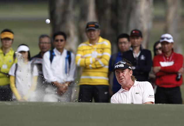 Miguel Angel Jimenez of Spain hits a bunker shot at the 9th hole during the Hong Kong Open golf tournament in Hong Kong, Sunday, Dec. 8, 2013