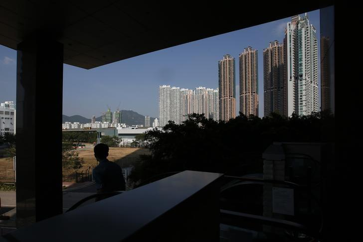 Hong Kong steps up efforts to cool red-hot property market