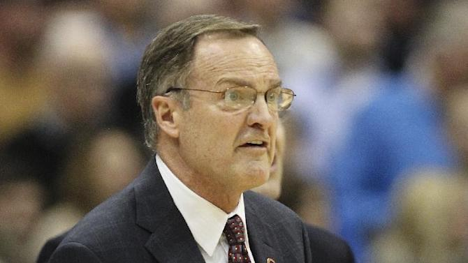 Oklahoma coach Lon Kruger reacts during the first half of a regional semifinal against Michigan State in the NCAA men's college basketball tournament Friday, March 27, 2015, in Syracuse, N.Y. (AP Photo/Nick Lisi)
