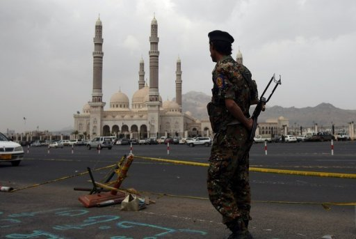 <p>A Yemeni soldier stands guard outside the al-Saleh mosque in Sanaa. Yemeni troops from the elite Republican Guard force -- led by the son of ousted president Ali Abdullah Saleh -- have attacked the headquarters of the defence ministry in Sanaa.</p>