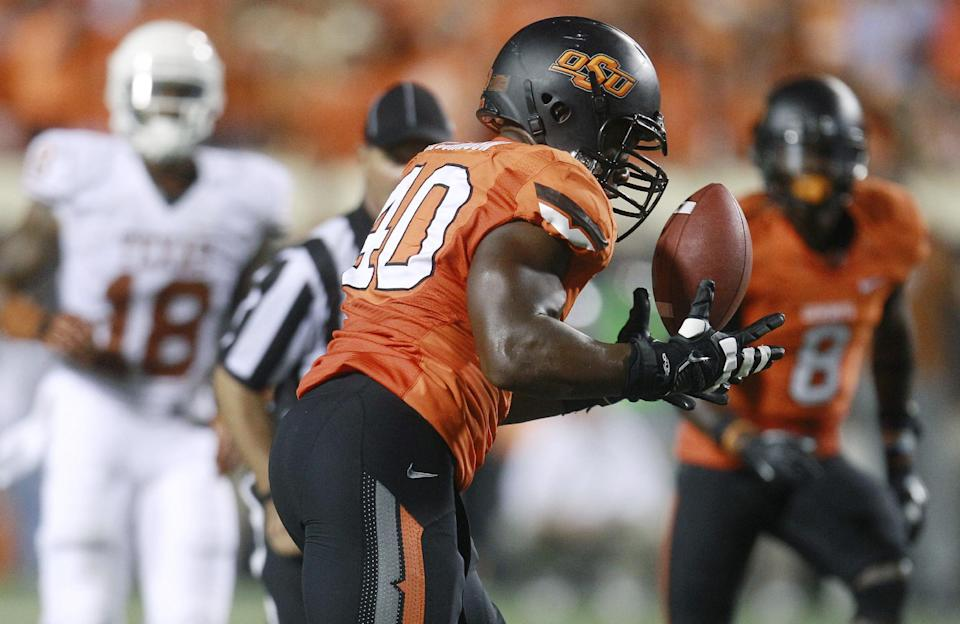 Oklahoma State defensive end Tyler Johnson intercepts a pass against Texas in the third quarter of an NCAA college football game in Stillwater, Okla., Saturday, Sept. 29, 2012. Texas won 41-36. (AP Photo/Sue Ogrocki)