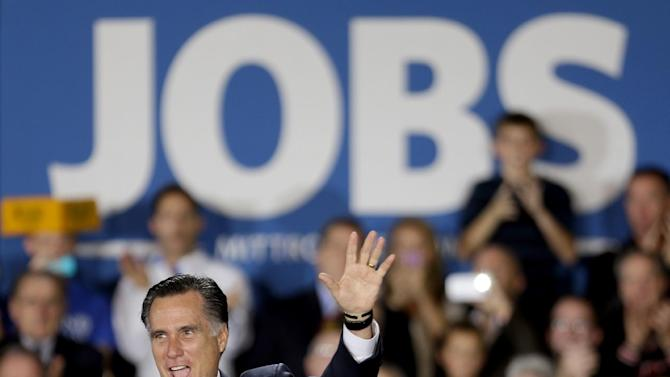 Republican presidential candidate, former Massachusetts Gov. Mitt Romney waves to supporters before speaking at a campaign event at Wisconsin Products Pavilion at State Fair Park, Friday, Nov. 2, 2012, in West Allis, Wisc. (AP Photo/David Goldman)