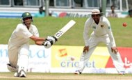 Pakistan batsman Younis Khan (left) plays a shot as Sri Lanka&#39;s Tillakaratne Dilshan looks on during the fourth day of the opening Test Match between Sri Lanka and Pakistan in Galle. Nuwan Kulasekara and Suraj Randiv combined to vanquish Pakistan as Sri Lanka triumphed in the first Test by a massive 209 runs, their biggest win over their Asian rivals
