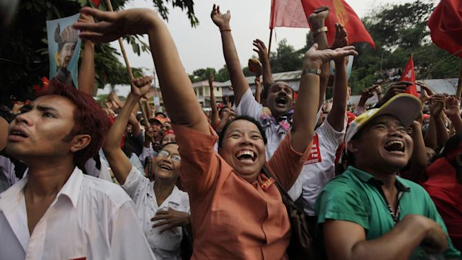 Aung San Suu Kyi's National League for Democracy party supporters cheer upon the party's announcement in Yangon, Myanmar, Sunday, April. 1, 2012. Supporters of Suu Kyi erupted in euphoric cheers Sunday after her party said she won a parliamentary seat in a landmark election, setting the stage for her to take public office for the first time. (AP Photo/Altaf Qadri)