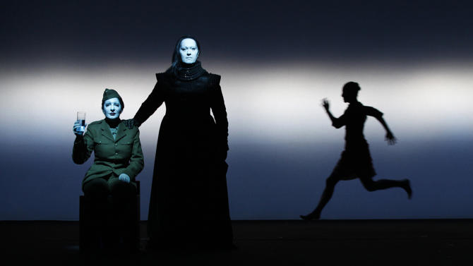 """In this 2011 photo released by Rio Film Festival, performance artist Marina Abramovic, left, performs during the making of the documentary film """"Bob Wilson's Life and Death of Marina Abramovic."""" The film, by director Giada Colagrande, chronicles the staging of a play loosely based on Abramovic's traumatic childhood at the hands of an abusive and tyrannical mother. The film is playing at the 2012 Rio de Janeiro International Film Festival. (AP Photo/Lucie Jansch, Rio Film Festival)"""