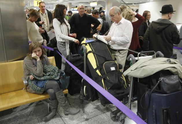 Passengers queue in Terminal 3 at Heathrow Airport in west London