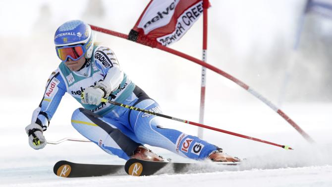 Sweden's Jessica Lindell-Vikarby bends a gate as she heads down course during the first run of the women's World Cup giant slalom skiing event, in Beaver Creek, Colo., Sunday, Dec. 1, 2013. (AP Photo/Charles Krupa)