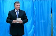 Ukrainian President Viktor Yanukovych holds his ballot at a polling station during parliamentary elections in Kiev on October 28. Ukraine's ruling party was set Monday to beat the allies of jailed ex-premier Yulia Tymoshenko in legislative elections that observers condemned as a setback for the ex-Soviet state's nascent democracy