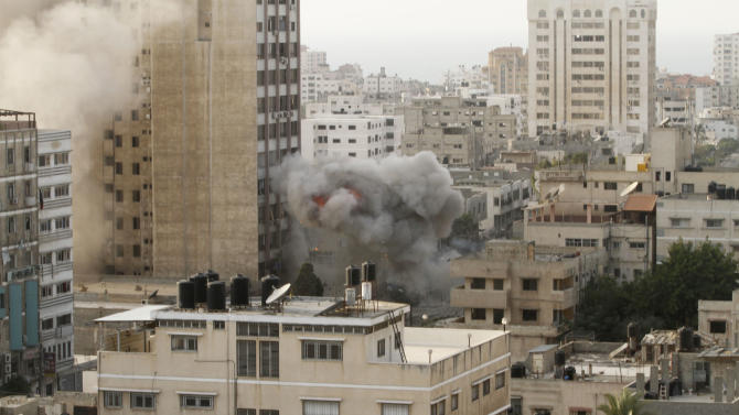 Smoke is seen  from an explosion by a high rise housing media organizations in Gaza City, Monday, Nov. 19, 2012. It's the Israel's military second strike on the building in two days. The Hamas TV station, Al Aqsa, is located on the top floor. (AP Photo/Hatem Moussa)