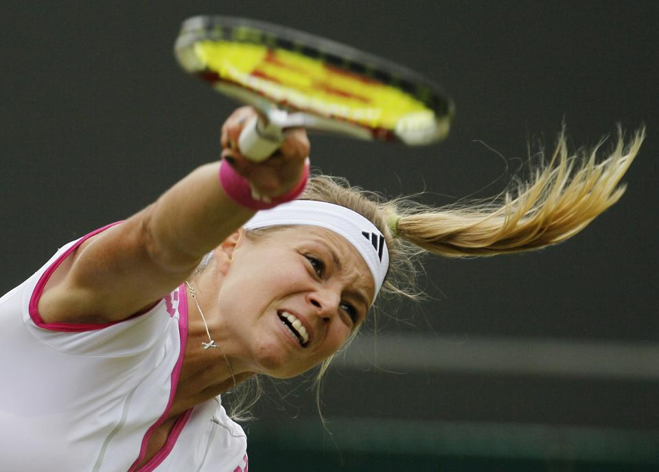 Russia's Maria Kirilenko serves a ball to Serena Williams of the US during their match at the All England Lawn Tennis Championships at Wimbledon, Saturday, June 25, 2011. (AP Photo/Alastair Grant)