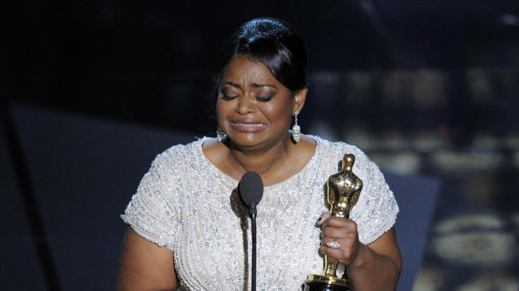"CORRECTS AWARD RECEIVED TO BEST ACTRESS IN A SUPPORTING ROLE INSTEAD OF ACTOR - Octavia Spencer accepts the Oscar for best actress in a supporting role for ""The Help"" during the 84th Academy Awards on Sunday, Feb. 26, 2012, in the Hollywood section of Los Angeles. (AP Photo/Mark J. Terrill)"