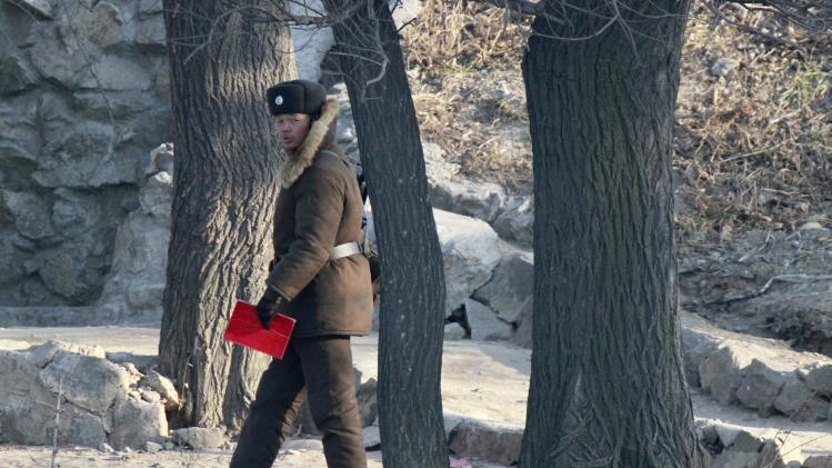 A North Korean soldier guards on the banks of Yalu River near the North Korean town of Sinuiju