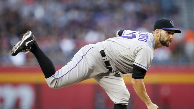 Stubbs hits 1st HR, Rockies beat Diamondbacks 5-4