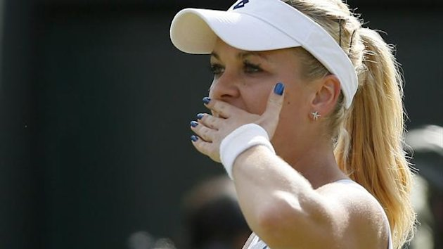 Agnieszka Radwanska of Poland celebrates after defeating Tsvetana Pironkova of Bulgaria in their women's singles tennis match at the Wimbledon Tennis Championships, in London July 1, 2013 (Reuters)
